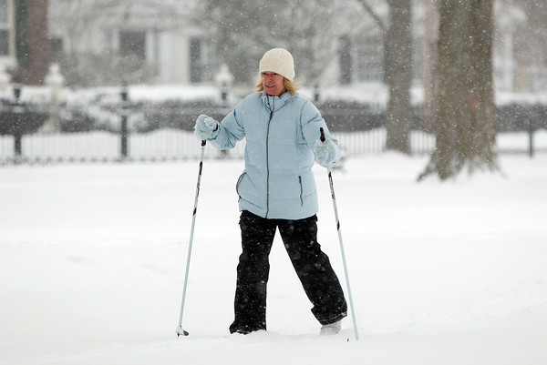 Salem: Trish Slam, of Salem, cross country skis around the Salem Common during Thursday's storm. DAVID LE/Staff Photo