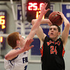Danvers: Beverly senior Nick Cross (24) takes a jumper while being closely defended by Danvers senior Keiran Beck (12) during an NEC clash between the Panthers and Falcons. Danvers rallied from a third quarter deficit to defeat Beverly 65-52 on Friday evening at Danvers High School. DAVID LE/Staff Photo 1/10/14