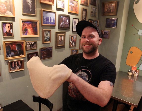 Salem: Tyler Griffin, of Flying Saucer Pizza Company in downtown Salem, is trying to go to the Olympics of Pizza Making and is hoping to break the world record for pizza dough stretching. DAVID LE/Staff Photo
