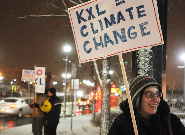 PAUL BILODEAU/Staff photo<br /> <br /> Hilary Hebert, a student at Salem State University and a resident of Beverly protests the Keystone XL pipeline along with a group of other protesters at Riley Plaza.
