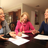 Wenham: From left, JoAnn Vizziello, Ann Krantz, Communications Lead of the Massachusetts Chapter of Moms Demand Action, and Ruth Bossler, all of Wenham, discuss some last minute details for their free informational event scheduled for Saturday January 25th at the Beverly Public Libaray starting at 2pm. DAVID LE/Staff Photo
