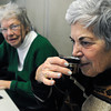 Ken Yuszkus/Staff photo:  Beverly:  Jean Richardson, right, smells dry white tea that was past around for a look and a sniff as Dot Ghika, left, looks on during the Tea Tasting at the Council On Aging Senior Community Center on Wednesday morning.