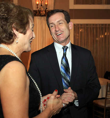 Danvers: New Beverly Mayor Mike Cahill, right, talks with Patrice Tierney, wife of Congressman John Tierney, during the Mayor's Inaugural Ball held at the Danversport Yacht Club on Saturday evening. DAVID LE/Staff Photo