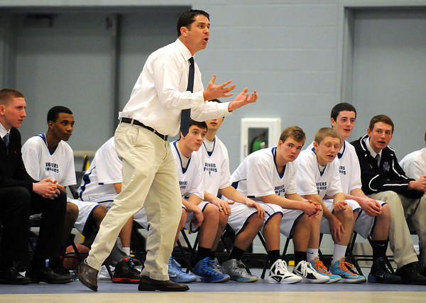 PAUL BILODEAU/Staff photo<br /> <br /> An animated Danvers High School head basketball coach John Walsh during the Falcons game against Lynn English in Danvers.