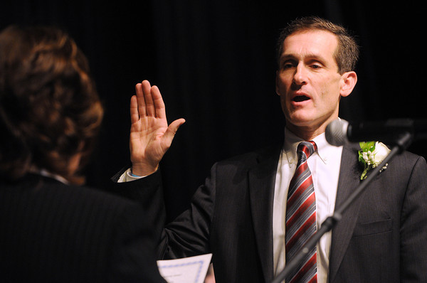 Ken Yuszkus/Staff photo: Beverly: Michael Cahill takes the oath of office for mayor of Beverly during the Beverly inaugural held at Beverly High School.