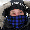 Ken Yuszkus/Staff photo: Beverly:  Chris Sadkowski is bundled up to fight the frigid weather while walking the streets of Beverly. The low temperatures and wind will stick around for a few days.