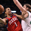 Boston: Philadelphia 76ers rookie and Hamilton, MA native Michael Carter-Williams (1) tries to get around Boston Celtics Rookie Kelly Olynyk  (41) during the fourth quarter of play on Wednesday evening. DAVID LE/Staff Photo 1/29/14