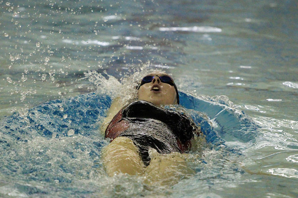 Peabody: Marblehead senior captain Ryan Alexander cuts through the water during the backstroke leg of the 200IM against Peabody on Thursday evening at the Torigian Family YMCA. DAVID LE/Staff Photo