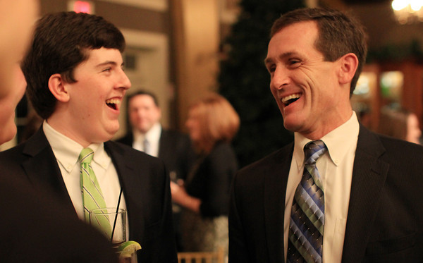 Danvers: New Beverly Mayor Mike Cahill talks with his nephew Liam Cahill, left, during the Mayor's Inaugural Ball held at Danversport Yacht Club on Saturday evening. DAVID LE/Staff Photo