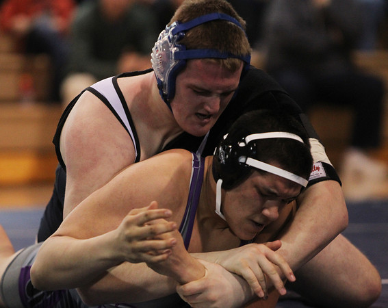 Danvers: St. John's Prep heavyweight wrestler Jay Carnevale, left, grapples with Shawsheen Tech's Zach Zafris, during a quad-meet at St. John's Prep on Monday morning. DAVID LE/Staff Photo