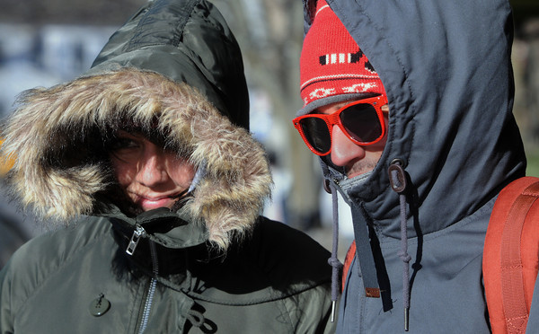 Ken Yuszkus/Staff photo: Salem: Stacey Cicivelli and Frank Morda, both of Australia, are bundled up to fight the icy cold temperaure and biting wind while visiting Salem.