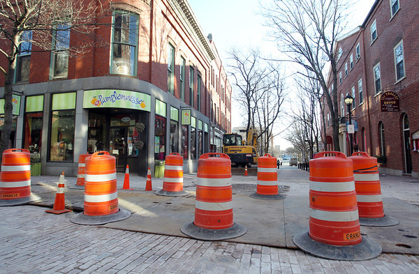 Salem: Work is being done at the intersection of Central and Essex Streets in the Pedestrian Mall in downtown Salem. DAVID LE/Staff Photo
