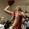 Lynnfield: Masco junior guard Amy Fogarty (21) takes a hook shot over Lynnfield senior Ashley McRae (3) during the Chieftans 53-45 win over the Pioneers in a matchup between the top two teams in the Cape Ann League on Friday evening. DAVID LE/Staff Photo