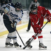 Peabody: Masco captain Dana Valletti (10) and Peabody's Ciara DiSalvo (18) get tangled up while battling for possession of a loose puck on Wednesday afternoon. DAVID LE/Staff Photo