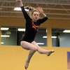 Beverly: Beverly gymnast Hannah Rennie flies through midair while performing on the balance beam against Masco at the Sterling Center YMCA on Friday evening. DAVID LE/Staff Photo 1/31/14