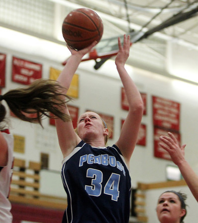 Salem: Peabody senior Carolyn Scacchi takes a jumper in the lane against Salem on Tuesday evening. DAVID LE/Staff Photo