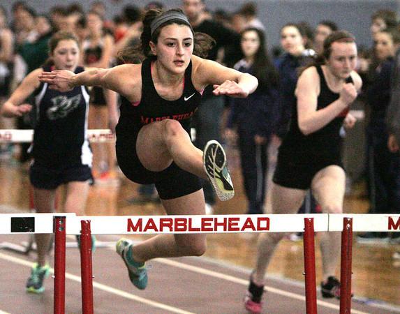 Ken Yuszkus/Staff photo: Marblehead: Marblehead's Olivia Vener wins her heat in the hurtles at the North Shore Tech at Marblehead boys/girls indoor track meet.