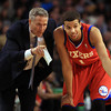 Boston: Philadelphia 76ers rookie point guard Michael Carter-Williams, right, gets a pointer from Philadelphia Head Coach Brett Brown during their game against the Boston Celtics on Wednesday evening. DAVID LE/Staff Photo 1/29/14