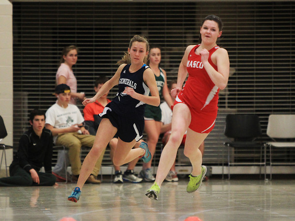 Ipswich: Hamilton-Wenham junior Kristen Heffernan, left, and Masco junior Lauren Drohosky, right, sprint neck and neck into the final straightaway on Friday afternoon. DAVID LE/Staff Photo