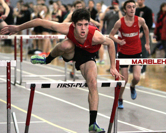 Ken Yuszkus/Staff photo: Marblehead: Marblehead's Conrad Rousseau goes over the last hurtle and wins his heat at the North Shore Tech at Marblehead boys/girls indoor track meet.