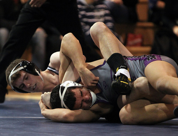 Danvers: St. John's Prep senior Jared Costa, left, has his Shawsheen Tech opponent, Efron Torres in a tough position during their 145-lb weight class match during a quad-meet held at St. John's Prep on Monday morning. DAVID LE/Staff Photo