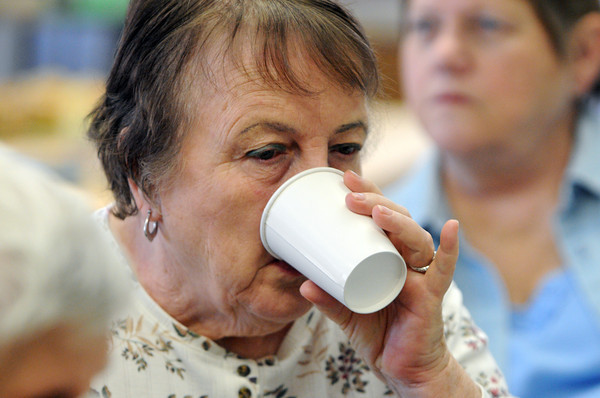 Ken Yuszkus/Staff photo:  Beverly:  Marjorie Malette tastes pomegranate tea during the Tea Tasting at the Council On Aging Senior Community Center on Wednesday morning.