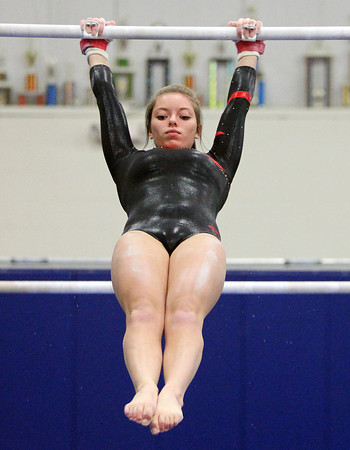 Beverly: Masco gymnast Jess DeMarco performs her uneven bars routine against Beverly at the Sterling Center YMCA on Friday evening. DAVID LE/Staff Photo 1/31/14