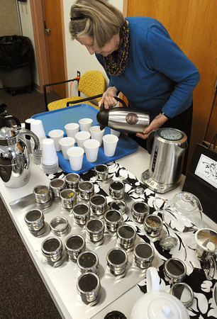 Ken Yuszkus/Staff photo:  Beverly:  Gail Knott pours oolong tea for sampling during the Tea Tasting at the Council On Aging Senior Community Center on Wednesday morning.