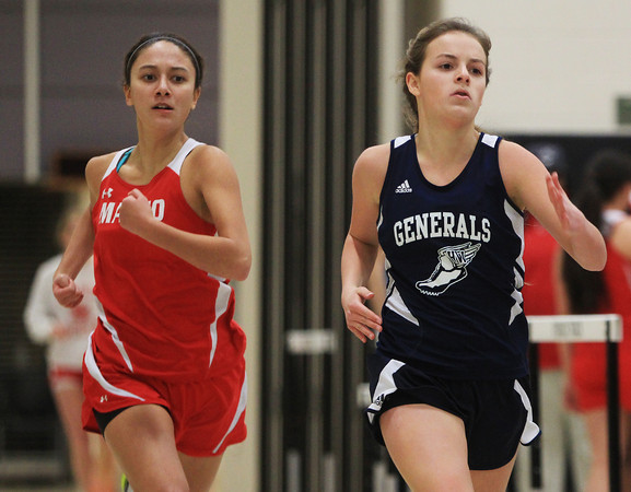 Ipswich: Masco senior Julianna Kostas, left, and Hamilton-Wenham sophomore Maddy Berthoud compete in the second heat of the 300 on Friday afternoon. DAVID LE/Staff Photo
