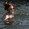 Ken Yuszkus/Staff photo: Salem: Caroline Ouellette, 75, of Salem, bathes in the water with her turkey hat during the 5th annual Freeze Your Tush Off ocean dip at the Winter Island boat ramp in Salem.
