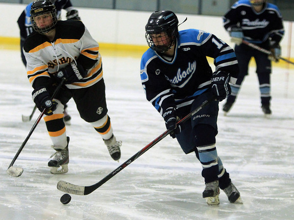 Peabody: Peabody forward Caroline Buckley (16) controls the puck and carries it up ice against Bishop Fenwick during a matchup between the Tanners and Lady Crusaders at McVann-O'Keefe Rink in Peabody. DAVID LE/Staff Photo 1/10/14