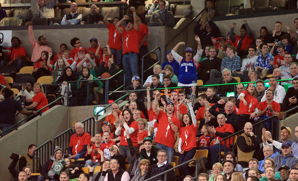 Boston: A large fan section for Hamilton native Michael Carter-Williams cheers loudly as the Philadelphia 76ers rookie hits a free throw to tie the game. DAVID LE/Staff Photo 1/29/14