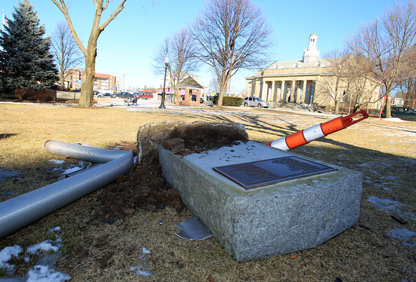 Beverly: Vandals tipped over a flag pole and a veterans memorial in Odell Park across from the Post Office along Rantoul Street in Beverly. In addition to destroying the landmarks, large tire tracks were found across the grass. DAVID LE/Staff Photo
