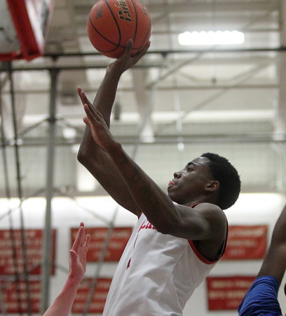 Salem: Salem senior forward Rashad Keys (1) takes a hook shot against Danvers on Tuesday evening. Salem defeated Danvers 41-38 in a closely contested game on Tuesday evening. DAVID LE/Staff Photo 1/14/14