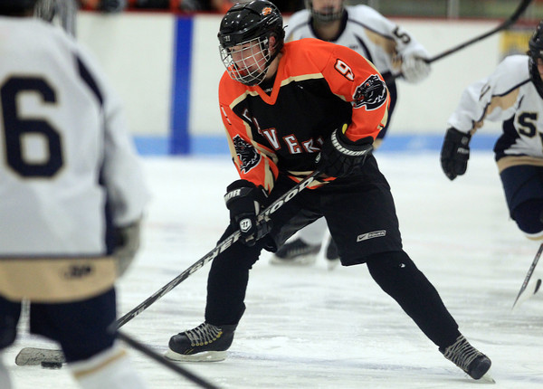 Lynn: Beverly sophomore Anna O'Neill (9) dangles with the puck against St. Mary's and looks to make a play during the third period of play on Saturday evening at the Connery Arena in Lynn. DAVID LE/Staff Photo