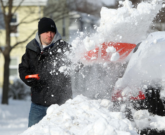 Salem: Rob Werkowski, of Salem, digs out his car on Friday morning as storm cleanup began. DAVID LE/Staff Photo