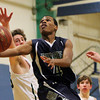 South Hamilton: Pingree senior guard Johnnie Spears (4) splits a few Concord Academy defenders and glides in for an easy layup on Friday evening. DAVID LE/Staff Photo 1/31/14