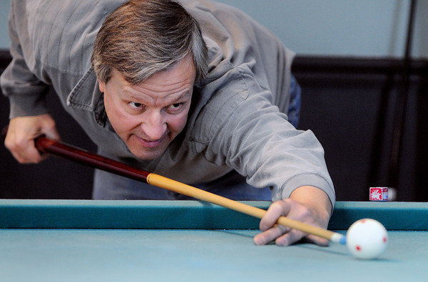 Ken Yuszkus/Staff photo: Peabody:  Mark Kolodziej lines up a shot on the pool table during a game with Rich Howcroft at the Peter A. Torigian Community Center.