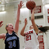 Salem: Salem guard Brianna Rodriguez (21) drives to the basket and tries to flip a shot over the block attempt from Peabody forward Carolyn Scacchi (34) on Tuesday evening. DAVID LE/Staff Photo