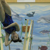 Peabody: Peabody sophomore Paige Hayward flips upside down during the diving event against Marblehead on Thursday evening at the Torigian Family YMCA. DAVID LE/Staff Photo