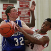 Salem: Salem sophomore Kelven Perpetuo (24) locks down on Danvers junior Peter Merry (32) as Merry tries to go up strong to the hoop during the second half of play on Tuesday evening. Salem defeated Danvers 41-38 in a closely contested game on Tuesday evening. DAVID LE/Staff Photo 1/14/14