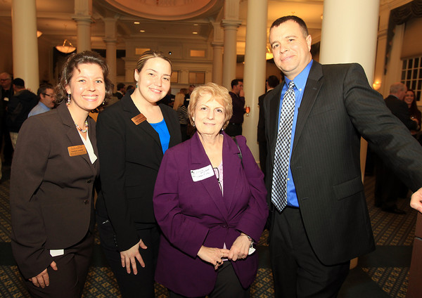 Salem: From left, Karen Chase, Janel Maysonet, Louise Mallett, and Jay Boyle III, of Salem Five, at the Salem Chamber of Commerce After Hours Networking event held inside the Salem Five Community Room on Wednesday evening. DAVID LE/Staff Photo