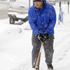 Ken Yuszkus/Staff photo: Beverly: Evan Scheiner shovels the sidewalk on Cabot Street where he works on Thursday morning.