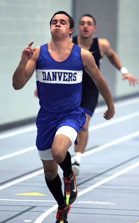 Ken Yuszkus/Staff photo: Danvers: Danvers' John Thomas wins his heat in the 55 meter dash during the Swampscott at Danvers indoor track meet.