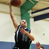 South Hamilton: Pingree junior guard Thomas Lennon (11) glides in for an easy layup against Concord Academy on Friday evening. DAVID LE/Staff Photo 1/31/14