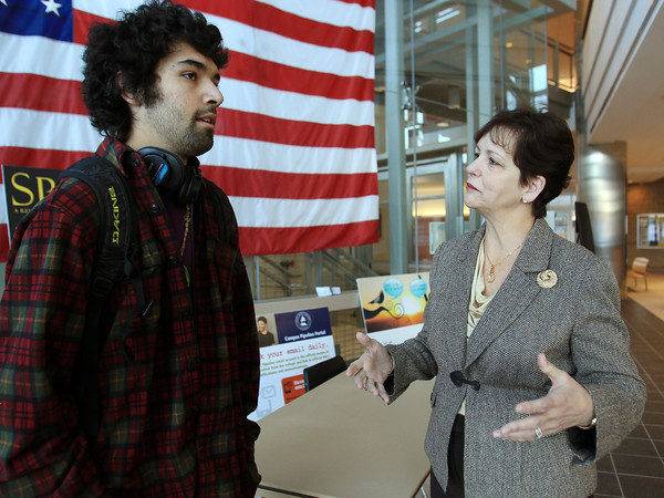 Danvers: New North Shore Community College President Patricia Gentile talks with first semester student Ben Wilson, of Rowley, on Wednesday afternoon. DAVID LE/Staff Photo