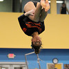 Beverly: Beverly junior Heather Gomes flips upside down during her balance beam routine against Masco at the Sterling Center YMCA on Friday evening. DAVID LE/Staff Photo 1/31/14