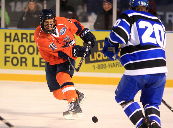 Boston: Salem State junior center Kristofer Faric (18) rifles a shot on net against UMass Boston on Tuesday afternoon. The Vikings fell to the Beacons 4-2. DAVID LE/Staff Photo