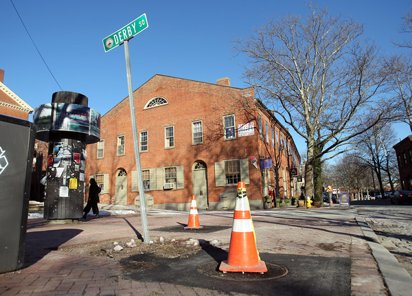 Salem: Construction work in downtown Salem has seen 10 new manhole covers be replaced along Front, Lafayette, and Central Streets. DAVID LE/Staff Photo