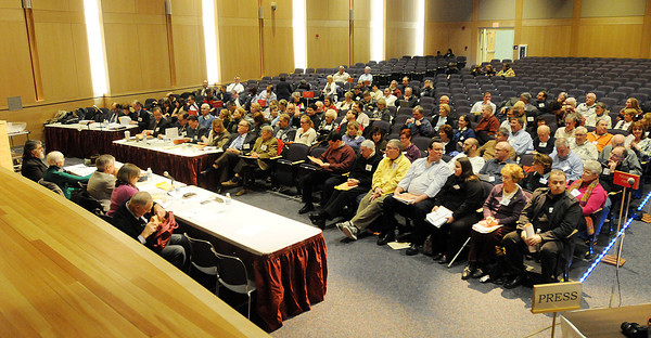 PAUL BILODEAU/Staff photo<br /> <br /> Danvers Town Meeting members are counted in at the start of Town Meeting last night in the auditorium at Danvers High School.